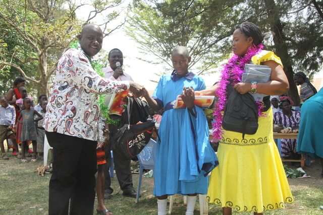 The Mumias constituency MP, Mr. Benjamin Njomo Washiali giving out school items