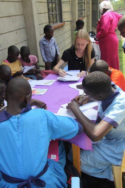 Children writing letter to their sponsors