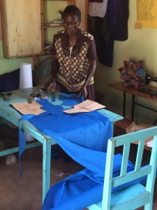 Judith, our cutter, preparing cuts for tailors
